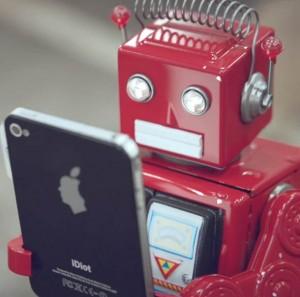 des petits robots rouges deviennet accro à un nouvel appareil appelé iDiot